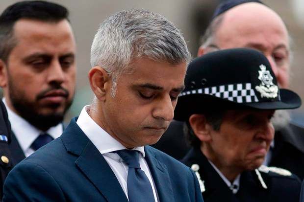 London Mayor Sadiq Khan bows his head during a vigil in London on Monday to commemorate the victims of the terror attack on London Bridge and at Borough Market that killed seven people on June 3. President Donald Trump criticized Khan multiple times on Twitter for statements the mayor made after the attacks.