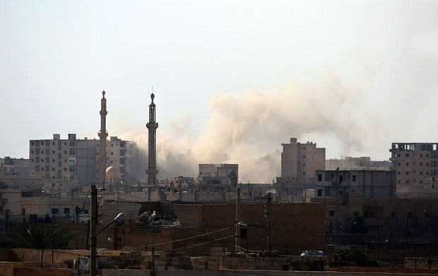 Smoke billows in the Syrian city of Raqqa's al-Sinaa district on Wednesday during an offensive by U.S.-backed fighters to retake the Islamic State bastion.