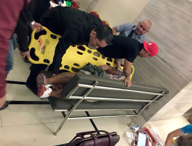 n injured man is placed on a stretcher after explosions rang out early Friday, June 2, 2017, at the Resorts World Manila complex near Manila's international airport in the Philippine capital, sparking a security alarm amid an ongoing Muslim militant siege in the country's south.