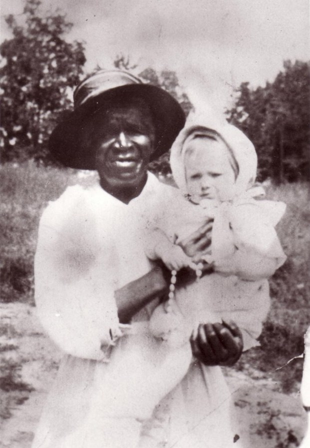 This 1916 photo provided by the Archdiocese of Denver shows Julia Greeley with Marjorie Ann Urquhart in McDonough Park in Denver. Greeley, a former slave, is being considered for possible sainthood. In a step toward possible sainthood, the remains of Greeley were moved to a Catholic cathedral in Denver. People lined up Wednesday, June 7, 2017, to honor her and pray for her help at the cathedral. (Archdiocese of Denver via AP)