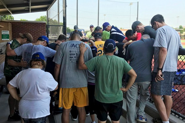 House Democrats at a baseball field in Washington, D.C., pray for their colleagues after hearing that a gunman fired on Republican lawmakers during baseball practice in Alexandria, Va., on Wednesday morning.