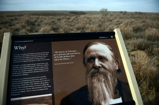 A descriptive sign with a picture of Colorado territorial Gov. John Evans greets visitors of the Sand Creek Massacre National Historic site in 2012.