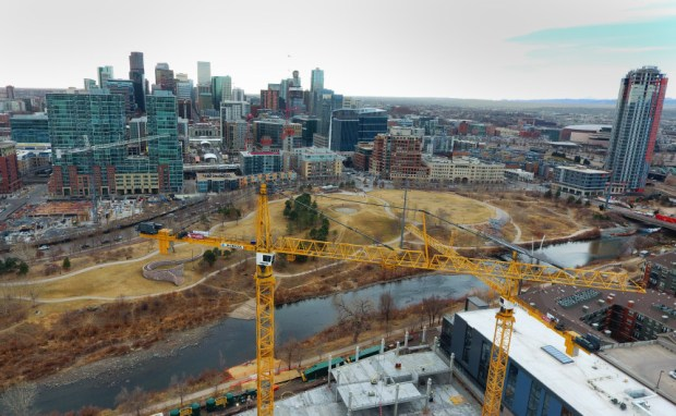 Cranes tower over a building under construction on Platte Street on March 3, as Denver's skyline continues to change.