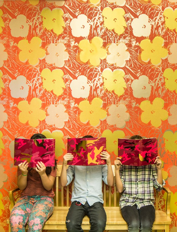 Flavor Paper's Flowers wallpaper, seen here in Miami Spice, has a Warhol feel ($360 per 15-foot roll, flavorpaper.com).