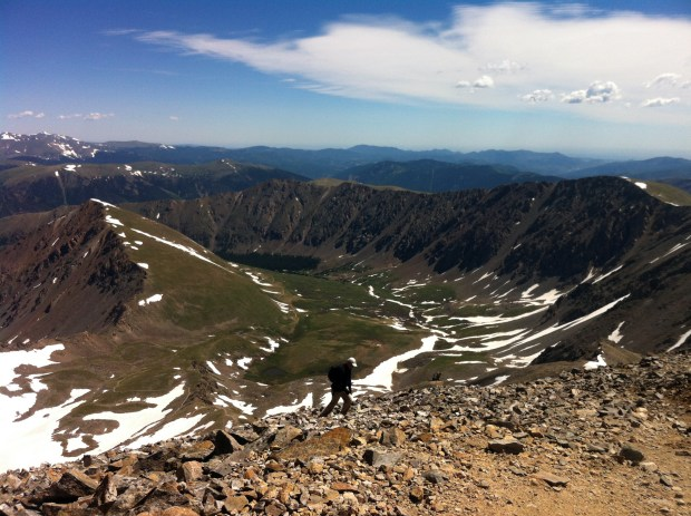 A hiker ascends Grays Peak in Summit County, which has the nation's most active citizens and longest lifespan.