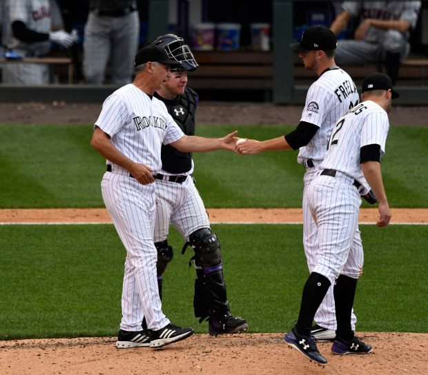 Rockies manager Bud Black (10) gets the ball from starting pitcher Kyle Freeland