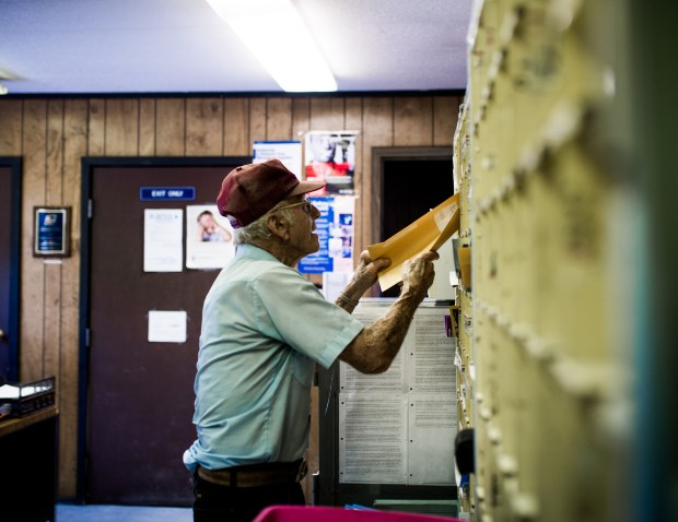Emory Townsend, 93, sorts the mail ...