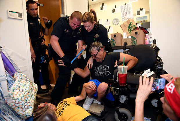 Police arrested 10 protesters -- most with disabilities -- in U.S. Sen. Cory Gardner's Denver office on Thursday, two days after they began a sit-in to demand that the Republican lawmaker pledge to oppose the GOP's plan to repeal and replace Obamacare.