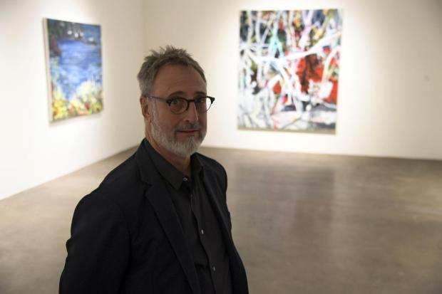 "Robischon Gallery owner Jim Robischon poses for a portrait on May 18, 2017, during an exhibit for its new multi-artist exhibition, called ""Out of View."" The gallery is located on Wazee Street in LoDo."