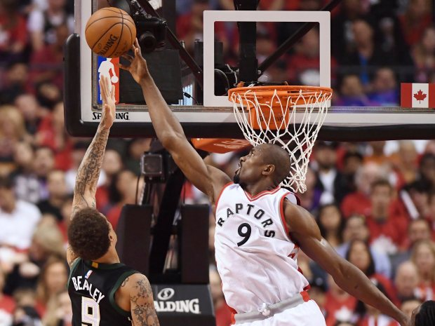 Toronto Raptors forward Serge Ibaka (9) blocks a shot from Milwaukee Bucks forward Michael Beasley (9) during the first half of game five of an NBA first-round playoff series basketball game in Toronto on Monday, April 24, 2017. (Frank Gunn/The Canadian Press via AP)