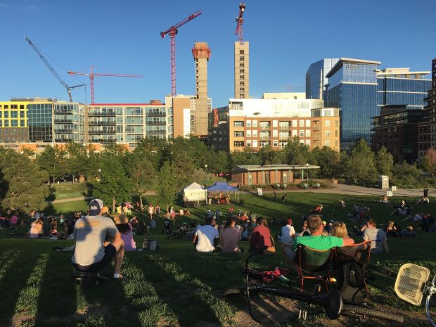 Attendees at Commons Park watch a concert by Le Pompe Jazz on June 4, 2017, at a free event put on by Swallow Hill Music.