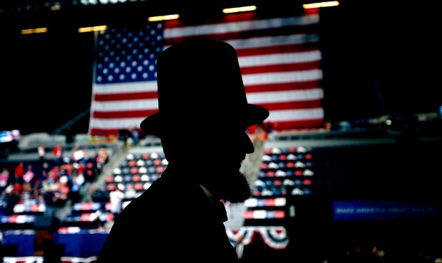 A man dressed as Abraham Lincoln walks through the crowd before the arrival of President Donald Trump at a June 21 rally Cedar Rapids, Iowa.