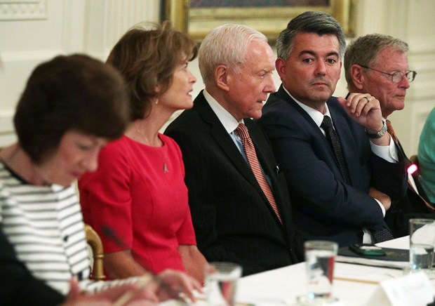 U.S. Sen. Cory Gardner (second from right) waits for the beginning of a health care meeting with President Donald Trump on June 27 at the White House.