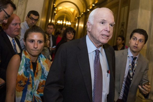 Sen. John McCain, R-Ariz., leaves the Senate chamber after voting against a Republican bill to repeal the Affordable Care Act early Friday.