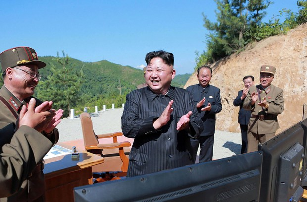 This picture released by North Korea's official Korean Central News Agency shows North Korean leader Kim Jong-un celebrating Tuesday's test-fire of an intercontinental ballistic missile from an undisclosed location.