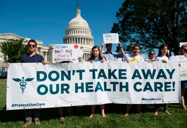 Protesters against the Better Care Reconciliation Act hold a rally outside the U.S. Capitol on June 28.