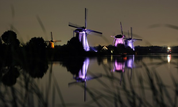 The World Heritage-listed Kinderdijk windmills are illuminated by LED lights, near Rotterdam, Netherlands.
