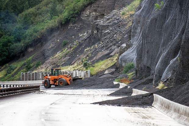 Colorado Department of Transportation workers work on clearing the eastbound side of Highway 82 from a rockslide at the Shale Bluffs near the Aspen Airport. Heavy thunderstorms Tuesday caused a series of rockslides that closed Highway 82 and eastbound traffic was diverted onto Owl Creek Road.
