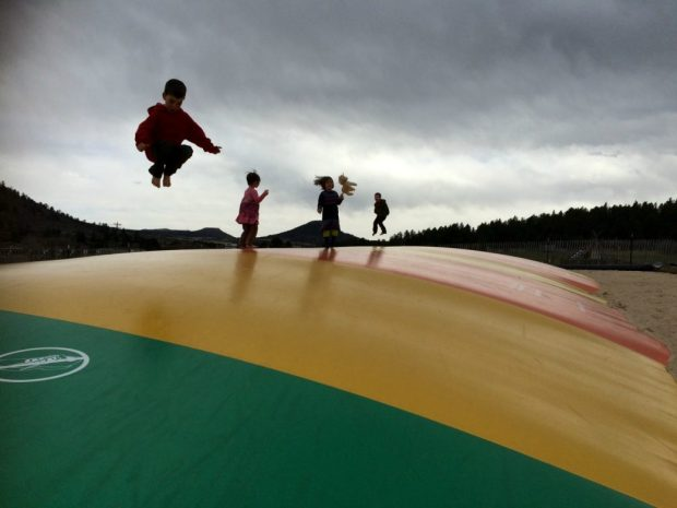 Kids bounce on the jump pillow at Yogi Bear's Jellystone Campground in Larkspur. (Joshua Berman, Special to The Denver Post)