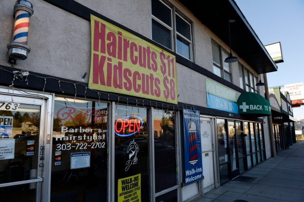 A marijuana shop sits next to a barbershop on South Broadway in Denver on Nov. 6, 2014.