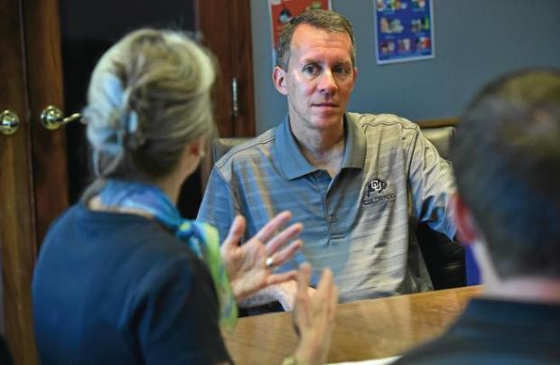 Bobby Braun, dean of the University of Colorado's College of Engineering and Applied Science, listens to a pitch of how to engage freshmen engineering students from Mary Steiner, assistant dean for students, during a meeting on the Boulder campus Thursday. Listening in the background are Ken Anderson and Megan Harris.