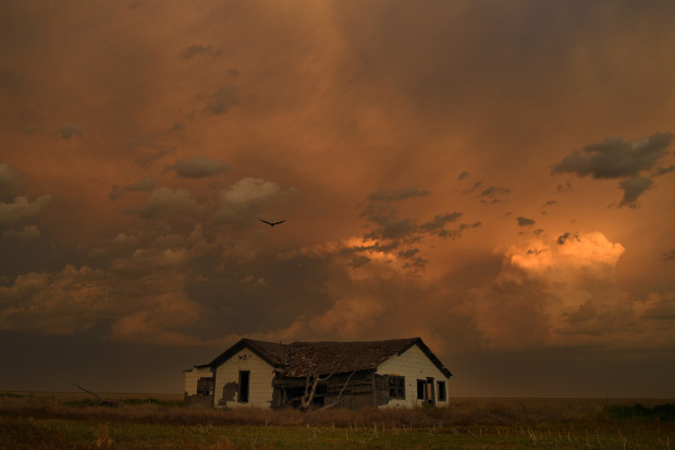 The sun sets over a long-vacated farmhouse in Lycan, in the southeast corner of Colorado. Baca County's population peaked in 1930.