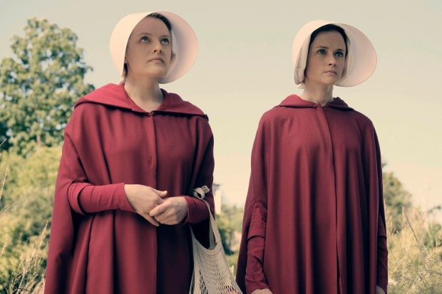 "(L-r) Elisabeth Moss stars as Offred and Alexis Bledel as Ofglen in ""The Handmaid's Tale,"" a series based on a novel by Margaret Atwood about a dystopian future."