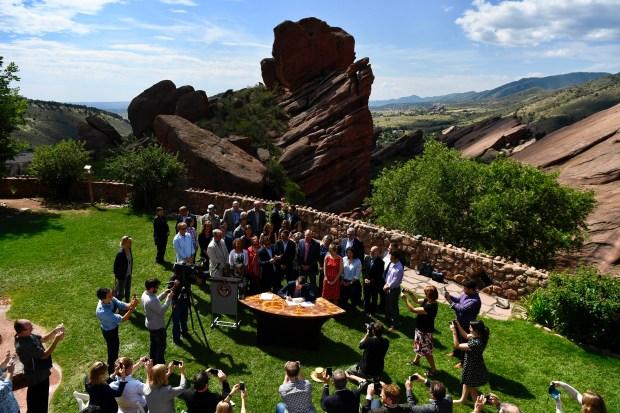 Colorado Governor John Hickenlooper signs an ...