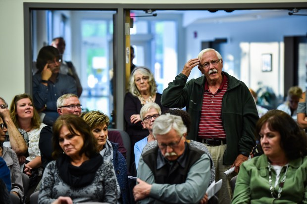 Larry Olson, 74, of Granite Falls, Minn., asks Dr. Ayaz Virji a question during his lecture on Islam at the Granite Falls, Minn., City Hall.