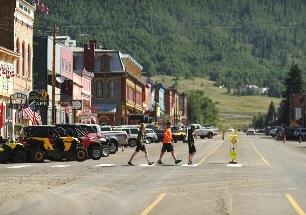 Visitors walk around historic downtown on June 27, 2017 in Silverton, Colorado.