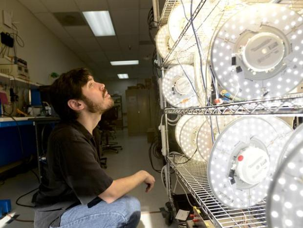 "Senior Electrical Engineer Anthony McDougle looks over the ""burn-in rack"" after making adjustments to LED lights in the research and development lab at Terralux in Longmont on Feb. 6, 2016. The company shut down earlier this month."