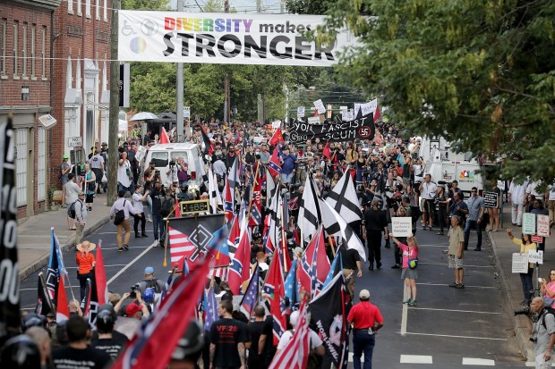 "Hundreds of white nationalists, neo-Nazis and members of the ""alt-right"" march down East Market Street toward Lee Park during the Aug. 12 ""United the Right"" rally August 12, 2017 in Charlottesville, Va."