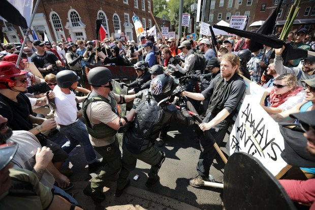 "White nationalists, neo-Nazis and members of the ""alt right"" clash with counter-protesters on Aug. 12 in Charlottesville, Va."