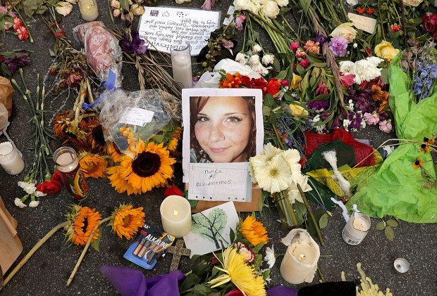 A memorial for Heather Heyer at the spot where she was killed and 19 others injured when a car slammed into a crowd of people protesting against a white supremacist rally in Charlottesville, Va.