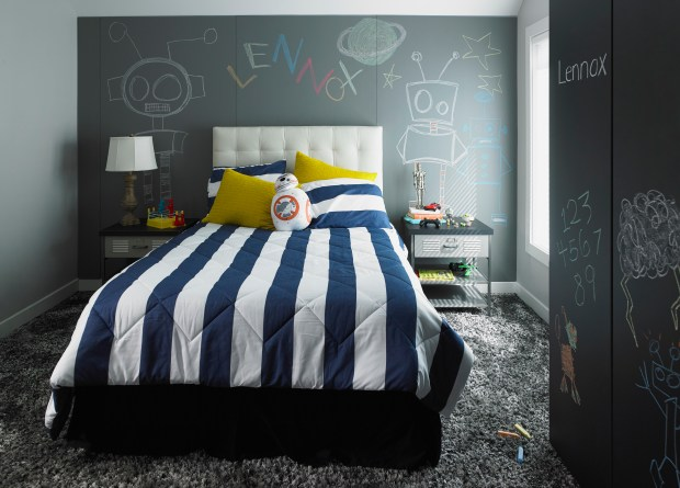 A child's bedroom that includes the new Formica Writable Surfaces in the Black ChalkAble design and the Gray ChalkAble design.