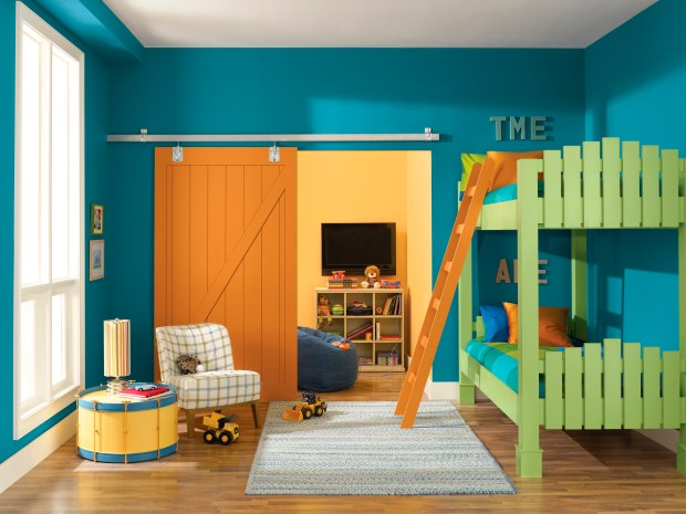A child's bedroom painted in Sherwin-Williams' color called Loch Blue.