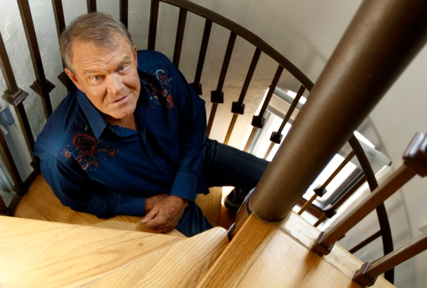 In this July 27, 2011 photo, musician Glen Campbell poses for a portrait in Malibu, Calif.