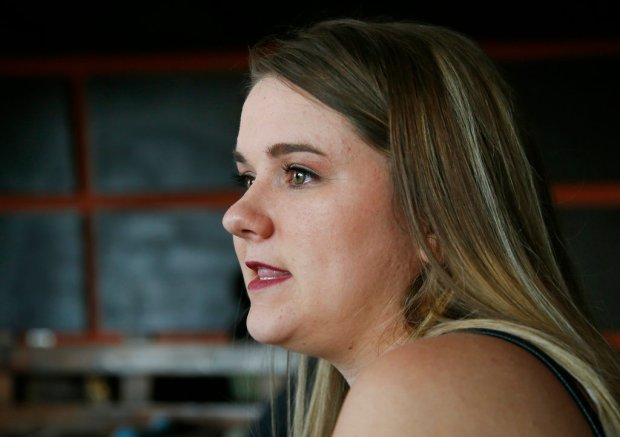 In this Wednesday, Aug. 9, 2017 photo, Danyelle Dyer talks during an interview in Edmond, Okla. Dyer had to obtain a court order after the man who molested her when she was 7 years old moved in next door. (AP Photo/Sue Ogrocki)