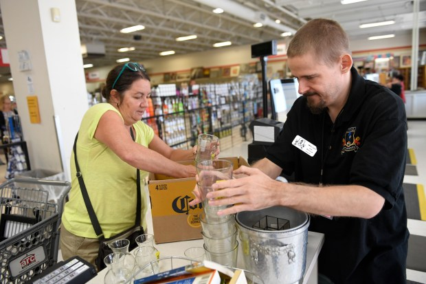 Seth Weshnak cashier checking out items for Jennifer Boone of Lakewood at the ARC Store on West Colfax Ave in Lakewood Aug. 11, 2017.
