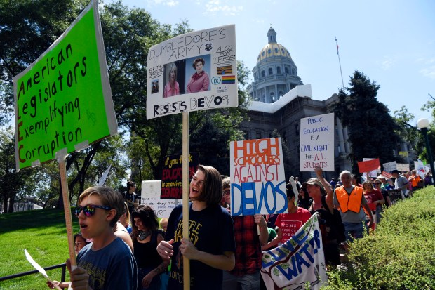 Hundreds of Colorado Education Association members and others march in protest of Education Secretary Betsy DeVos on July 19 near the Colorado Capitol.