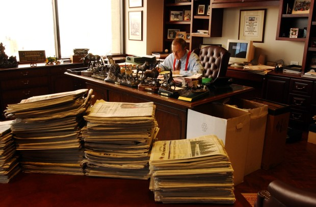 In an Oct. 4, 2001 photograph, William Dean Singleton, publisher of The Denver Post and chairman of the Denver Newspaper Agency, works in his office on the 21st floor of the Denver Post building.