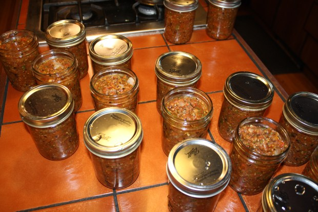 Canning salsa.