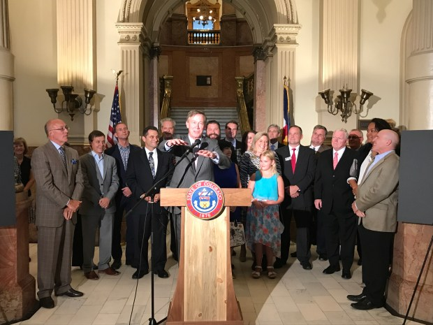 At an event inside the Capitol building, Gov. John Hickenlooper, Parker Mayor Mike Waid and others joined Redbarre CEO Don Levy in touting the proposedRedbarre Digital Media & Technology Campus.