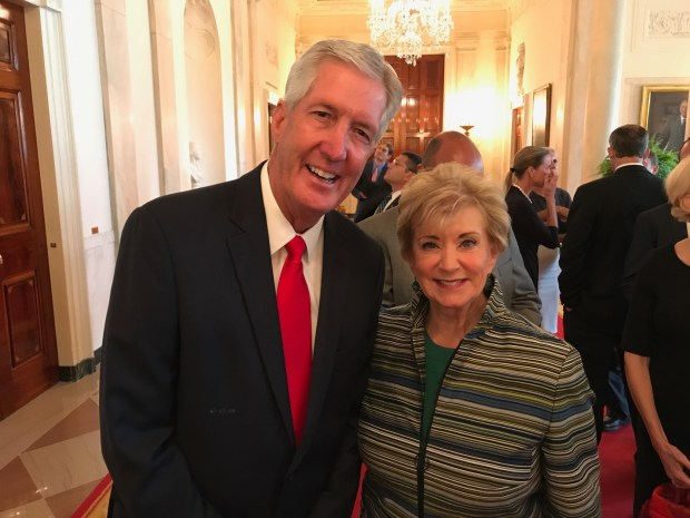 Rick Enstrom, left, whose family owns and operates Enstrom Candies, poses with Small Business Administration Administrator Linda McMahon. Enstrom attended a White House small business event on Tuesday where President Donald Trump spoke.