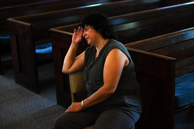 Rosa Sabido 53, pauses while telling ...