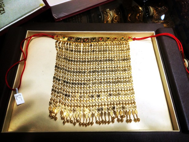 In Navrang Jewelers, in the gold souk, the writer tried on this gold necklace made in Bahrain. It cost more than $6,000.