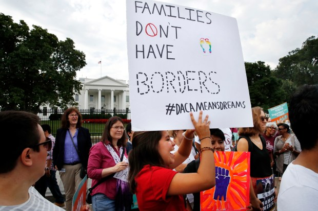 Supporters of the Deferred Action for Childhood Arrivals program, known as DACA, demonstrate outside of the White House on Tuesday.