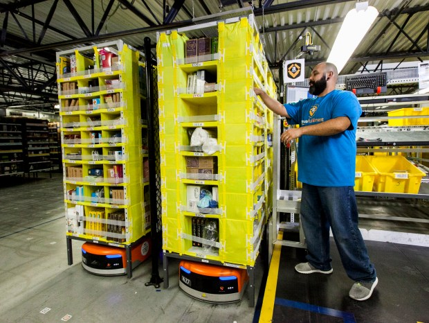 In Amazon's new robotics fulfillment centers, Amazon employees no longer need to spend their time walking up and down aisles to find items, The products, carried by Kiva robots, bring the items to workers. Amazon is building its first robotics fulfillment center in Thornton, which is expected to open in 2018.