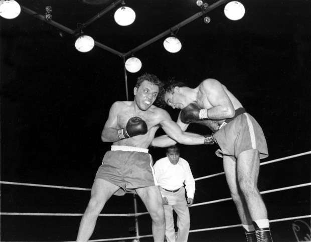 Jake LaMotta, left, pounds Marcel ...