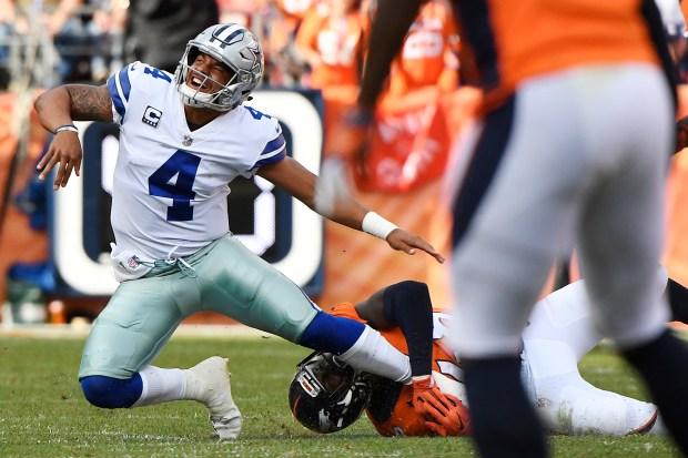DENVER, CO - SEPTEMBER 17: Shaquil Barrett (48) of the Denver Broncos knocks down Dak Prescott (4) of the Dallas Cowboys as he lets go of a pass during the second quarter on Sunday, September 17, 2017. The Denver Broncos hosted the Dallas Cowboys. (Photo by Joe Amon/The Denver Post)